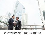 two businessman discussing for... | Shutterstock . vector #1013918185