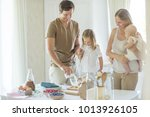 the family cooks in the kitchen  | Shutterstock . vector #1013926105