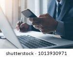 businessman in black suit using ...   Shutterstock . vector #1013930971