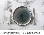 round plate with utensils on... | Shutterstock . vector #1013953915