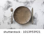 round plate with utensils on... | Shutterstock . vector #1013953921