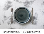 round plate with utensils on... | Shutterstock . vector #1013953945