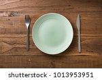 green round plate with utensils ... | Shutterstock . vector #1013953951