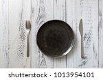 black round plate with utensils ... | Shutterstock . vector #1013954101