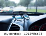 eyewear placed on the car... | Shutterstock . vector #1013956675