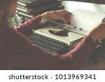 woman writing on the vintage... | Shutterstock . vector #1013969341