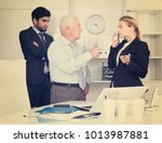 mature boss is chastising... | Shutterstock . vector #1013987881