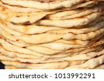 pita. pile of roasted pita ... | Shutterstock . vector #1013992291