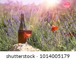 red wine bottle and wine glass... | Shutterstock . vector #1014005179
