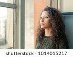 latin woman watching through... | Shutterstock . vector #1014015217