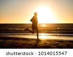 silhouette of young dynamic... | Shutterstock . vector #1014015547