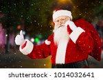 santa claus holding a bag   Shutterstock . vector #1014032641
