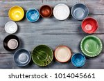 multicolored empty bowls on a... | Shutterstock . vector #1014045661