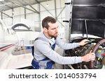 aircraft mechanic repairs an... | Shutterstock . vector #1014053794