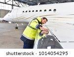 aircraft mechanic inspects and... | Shutterstock . vector #1014054295