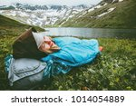 woman relaxing in sleeping bag... | Shutterstock . vector #1014054889