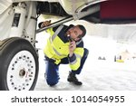 ground personnel at the airport ... | Shutterstock . vector #1014054955