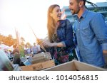 couple walking by flea market... | Shutterstock . vector #1014056815