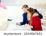 young couple buying ring in... | Shutterstock . vector #1014067651