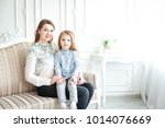 portrait of mother and daughter ... | Shutterstock . vector #1014076669