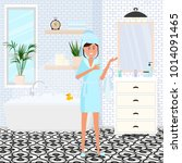 a young girl in a bathrobe in a ... | Shutterstock .eps vector #1014091465