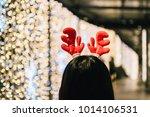 blur the back of a girl wearing ...   Shutterstock . vector #1014106531