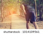 handsome man doing exercises... | Shutterstock . vector #1014109561