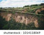 green grass covers hills under...   Shutterstock . vector #1014118069