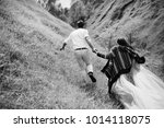 cheerful bride and groom hold...   Shutterstock . vector #1014118075