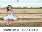 little girl in the bed in white ...   Shutterstock . vector #1014119119