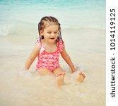 toddler girl on the beach   Shutterstock . vector #1014119125
