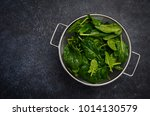 fresh green spinach leaves on a ... | Shutterstock . vector #1014130579