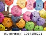 colorful hanging umbrellas   Shutterstock . vector #1014158221