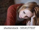 young woman feeling unhappy. | Shutterstock . vector #1014177337