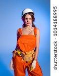 beautiful girl in overalls... | Shutterstock . vector #1014188995