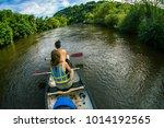 sailing along a river in ross... | Shutterstock . vector #1014192565