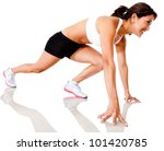 Female athlete in position to start running - isolated over a white background - stock photo