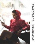 sport man in red hood listening ... | Shutterstock . vector #1014225961