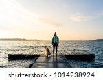 woman with dog enjoy sunrise... | Shutterstock . vector #1014238924