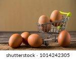 fresh egg on mini shopping cart ... | Shutterstock . vector #1014242305