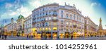 VIENNA, AUSTRIA - JANUARY 17: people in the streets in the city center of Vienna, Austria. Colorful illuminated stores, shops and restaurants at the Grabenstrasse on January 17, 2018 in Vienna,Austria - stock photo