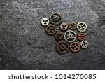 assorted metal gears on a dark... | Shutterstock . vector #1014270085