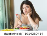 unhappy asian women is on... | Shutterstock . vector #1014280414