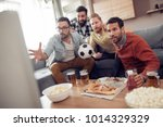 friends watching tv at home... | Shutterstock . vector #1014329329