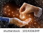 hand passes the coin bit in... | Shutterstock . vector #1014336349