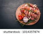 raw kebab from meat on a wooden ... | Shutterstock . vector #1014357874