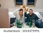 friends watching sport on tv at ... | Shutterstock . vector #1014375991
