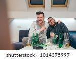 friends watching sport on tv at ... | Shutterstock . vector #1014375997