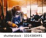 profesional welder in... | Shutterstock . vector #1014380491