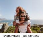 smiling man giving piggyback... | Shutterstock . vector #1014398359